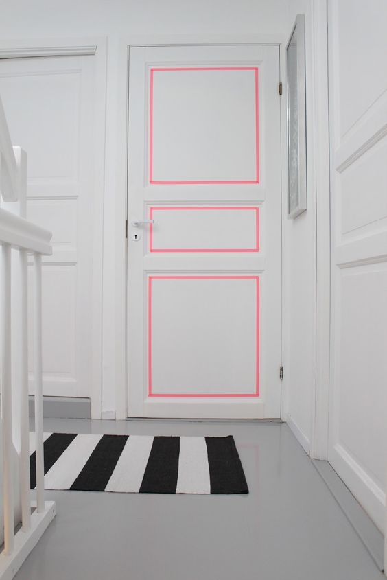 Neon washi tape to make the bad molding on the door look bad in a good way. ( source )