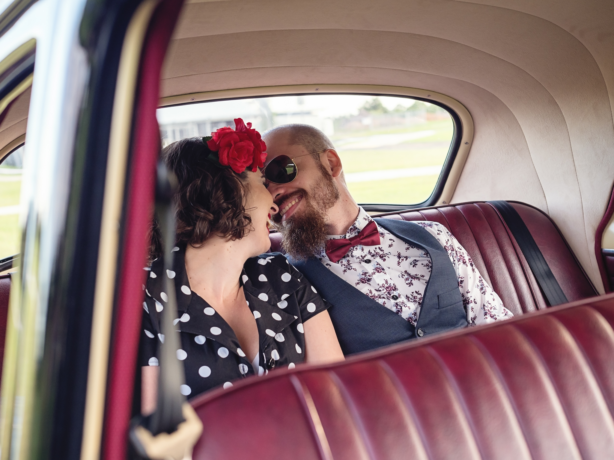 Couple-Back-Seat-of-Hot-Rod-Before-Proposal.jpg