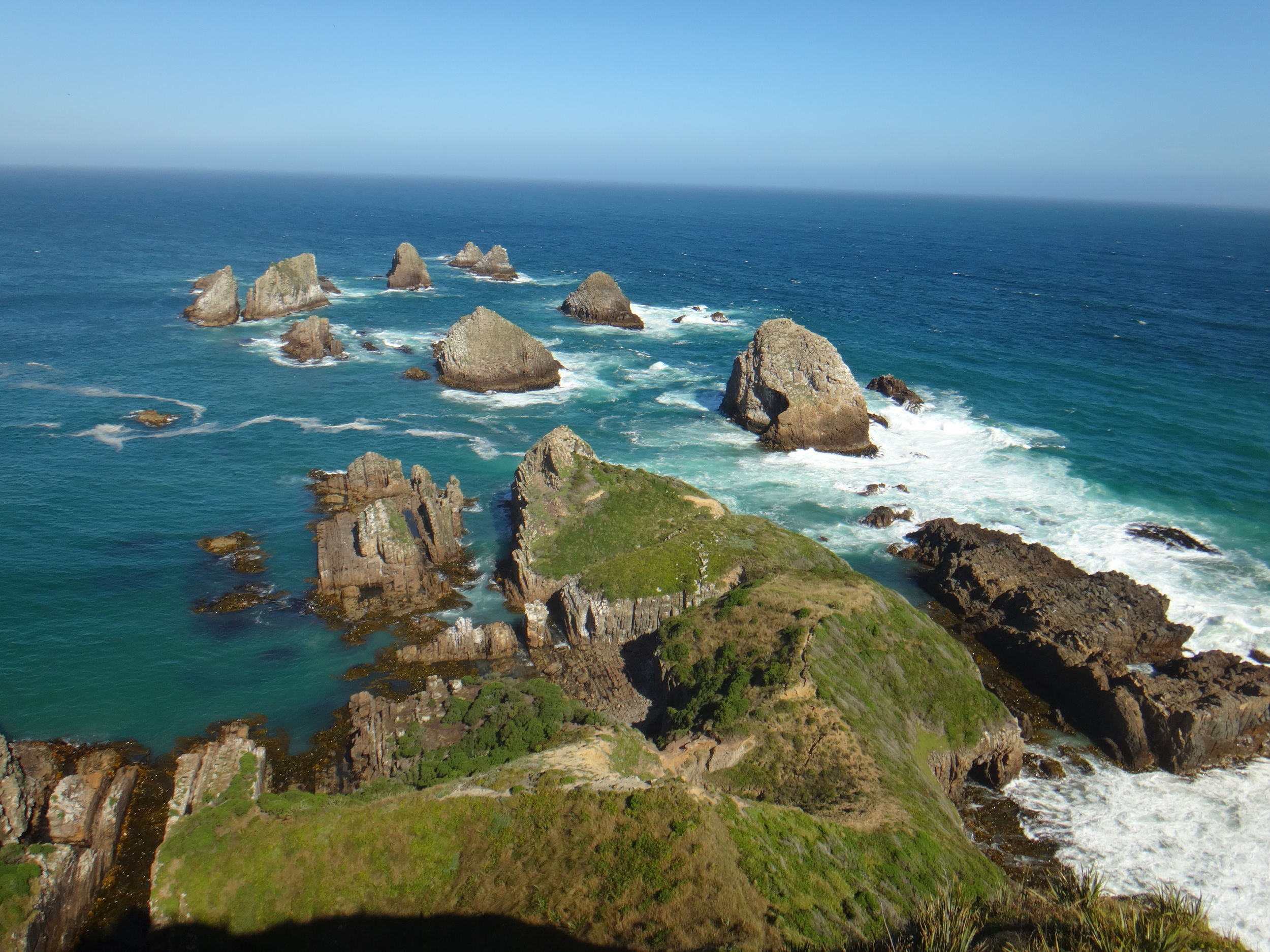 Nugget Point,calm and rough seas meeting