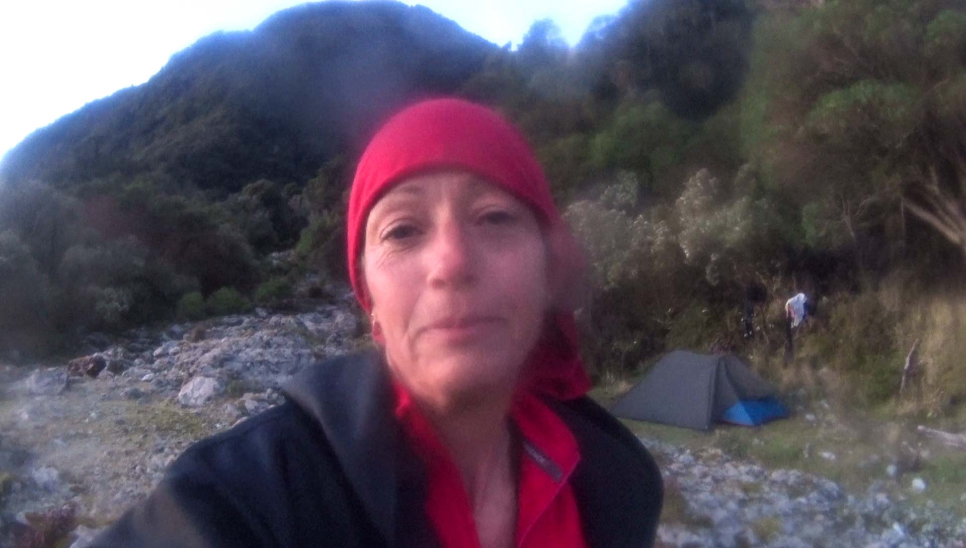 Happy Red at campsite in Bligh Sound