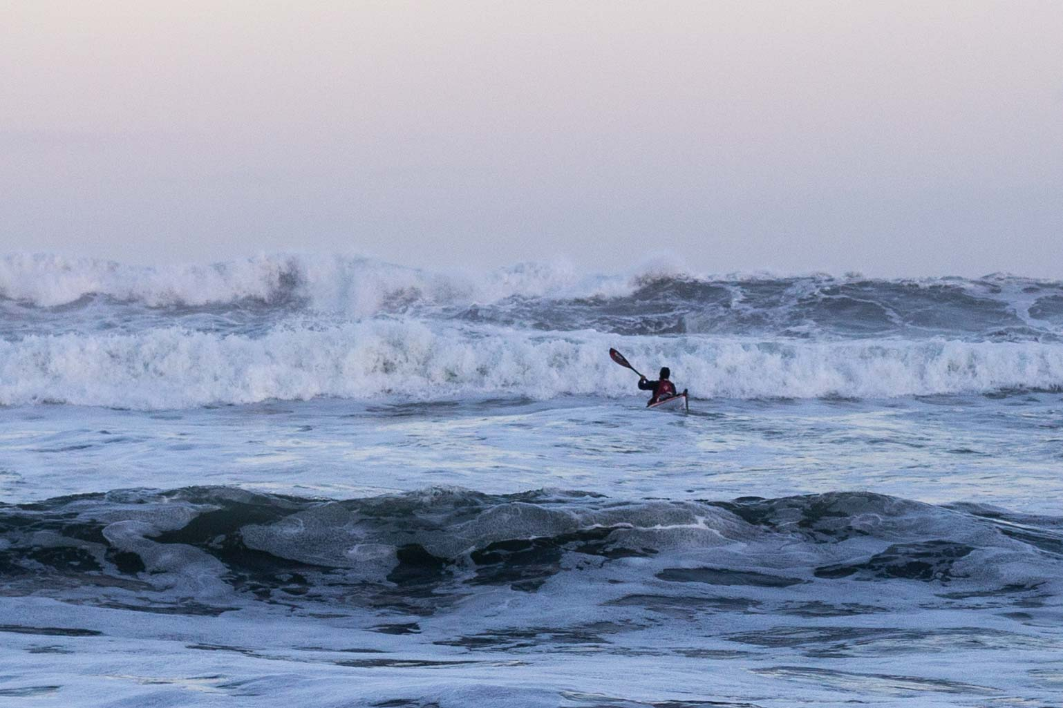 Red and T2 dwarfed by the huge swell this morning