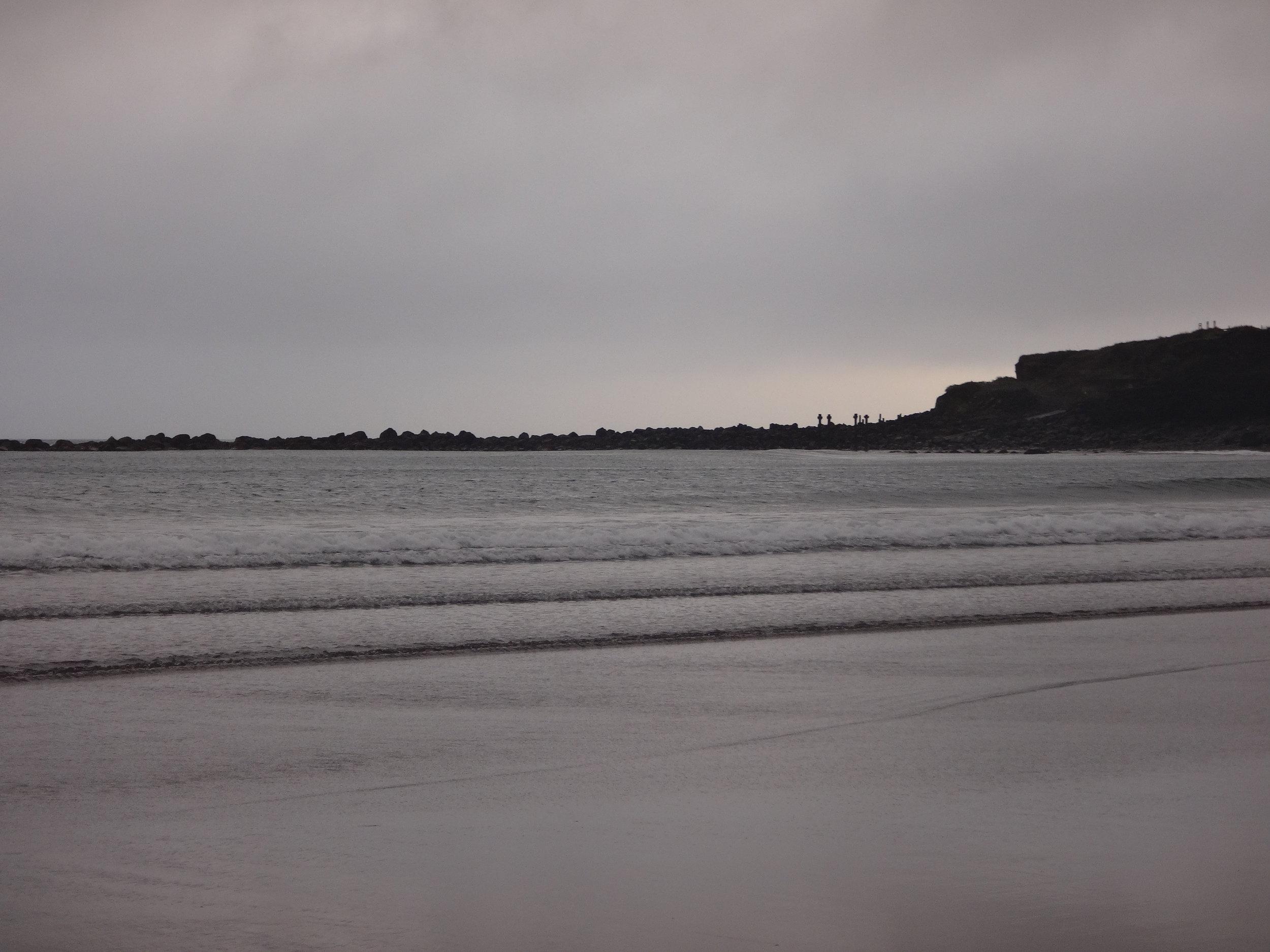 Opunake Beach. Grey, stormy clouds on a grey evening.