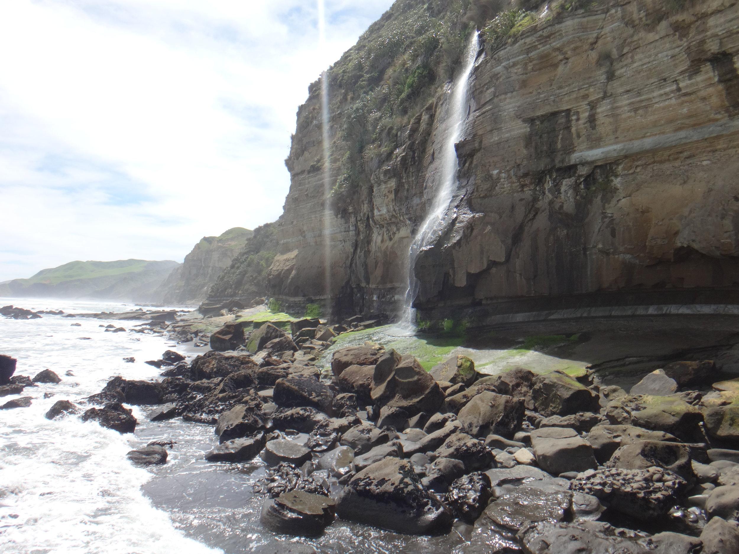 Waterfalls from the cliffs in Taranaki.