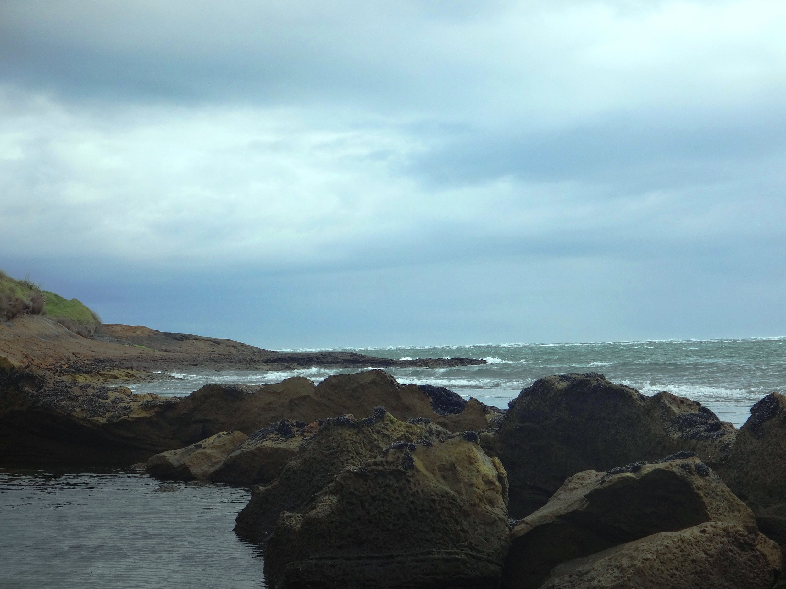 Rocks, rock-pools and harbour waves.