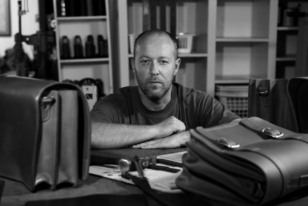 Santiago Carballo master craftsman in his workshop and shop