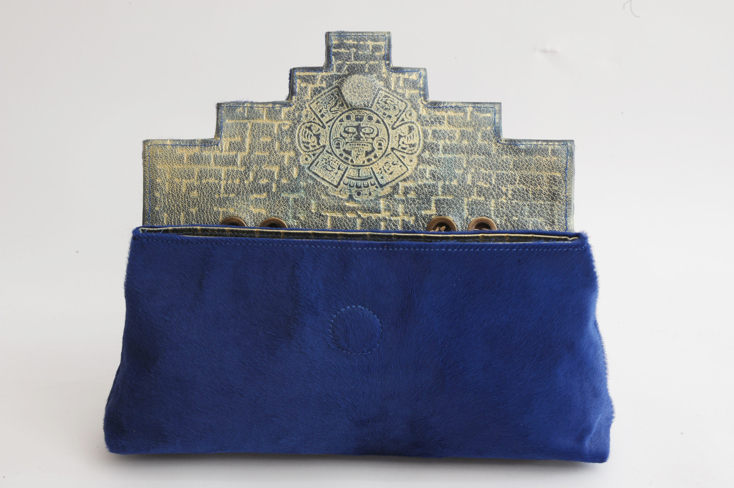 Beautiful blue of Azteca design with embossed interior .