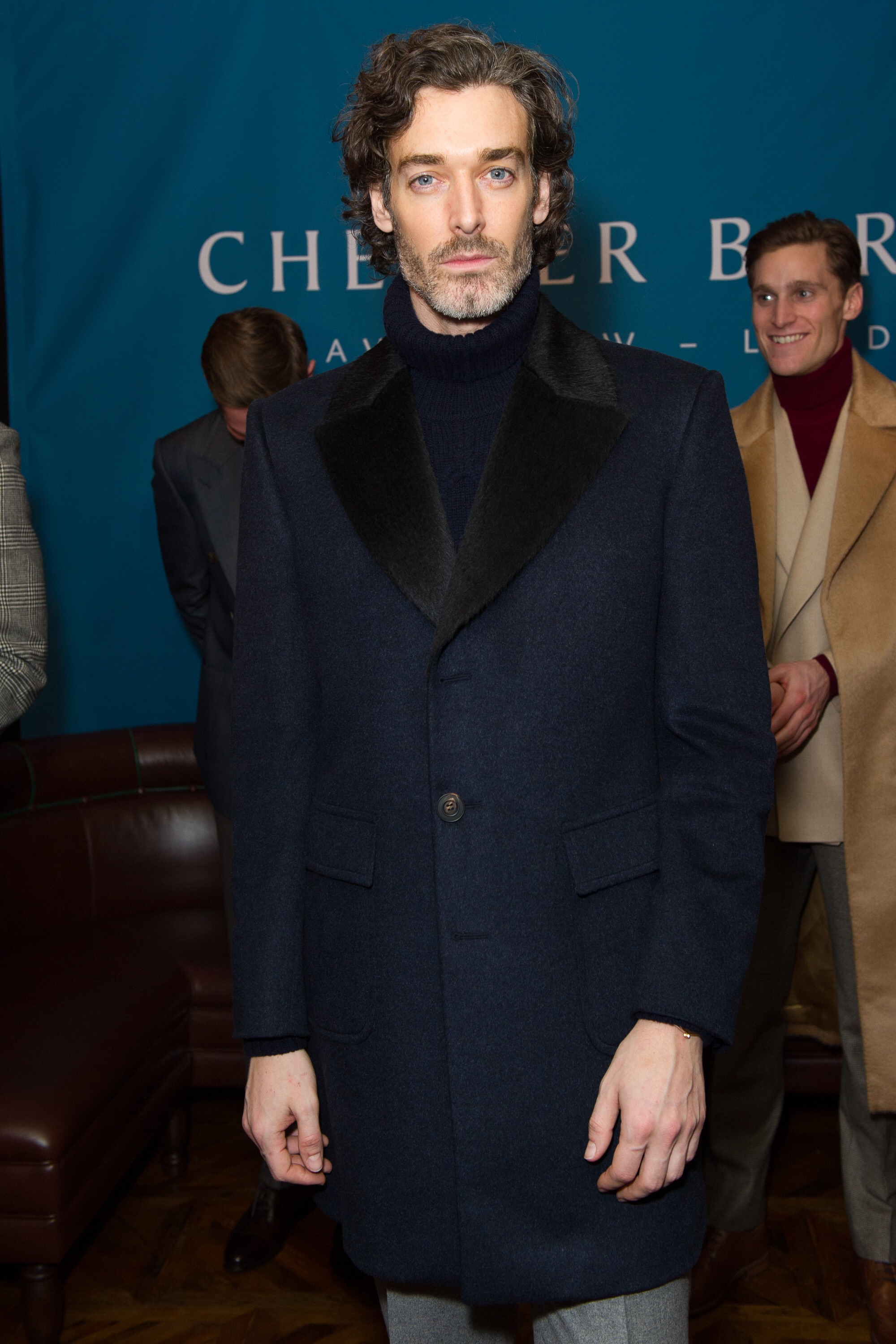 Model Richard Biedul in blue wool top coat with alpaca collar from the AW17 collection