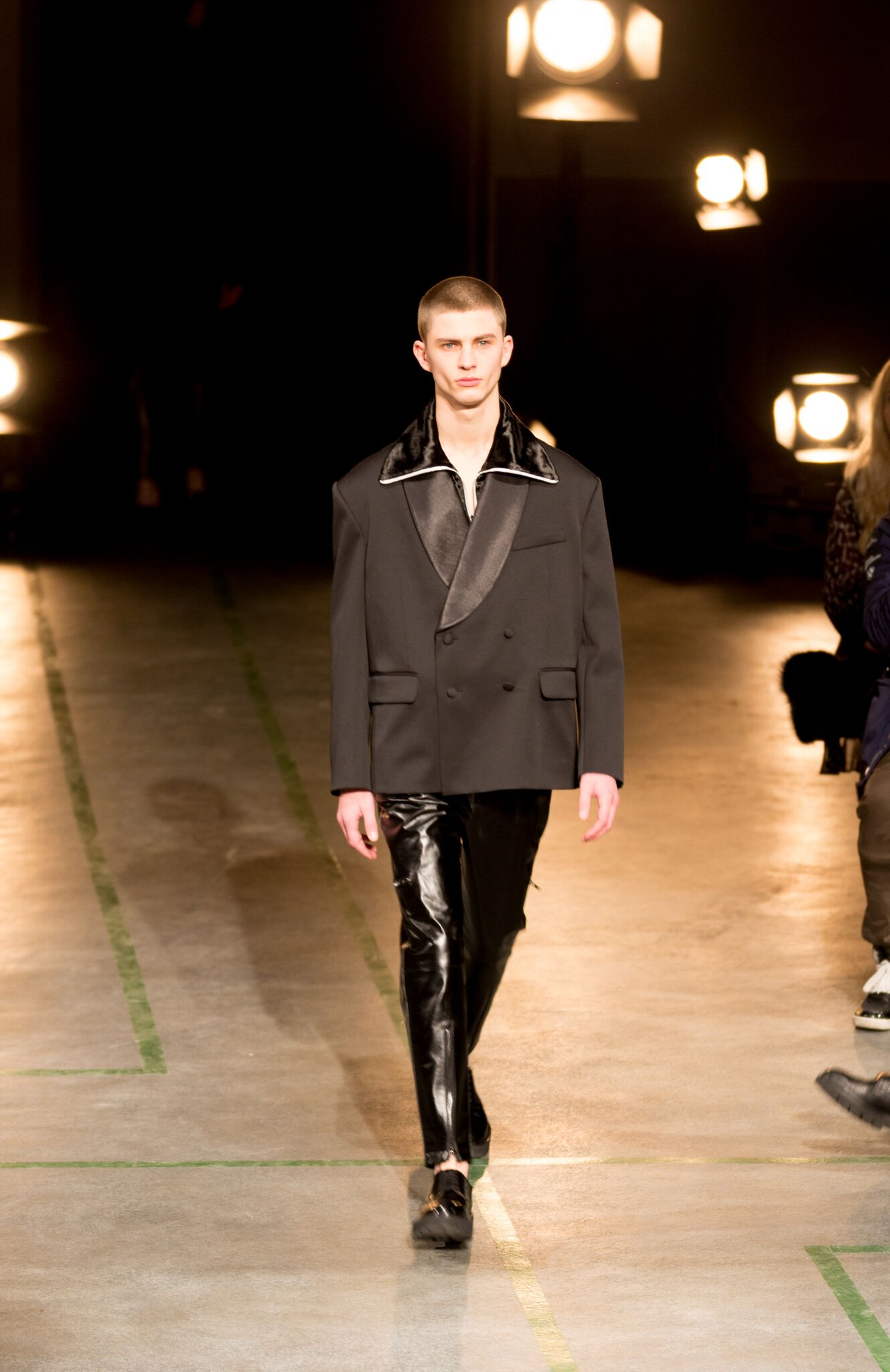 Spread out collars layered with tapered leather trousers.