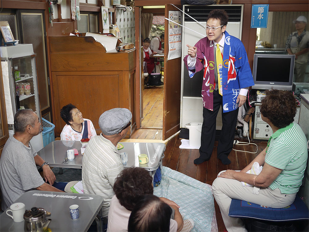 Furo Wakuzo entertains elderly customers at a local public bath in Adachi ward, Tokyo.
