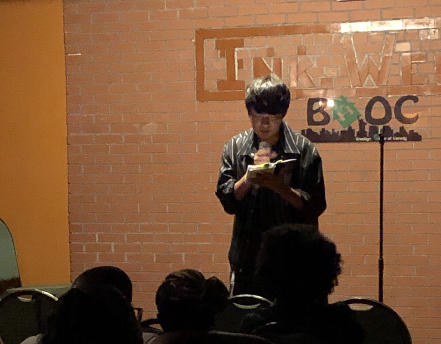 Muramoto Daisuke performing at an open mic night in New York in July, 2019.