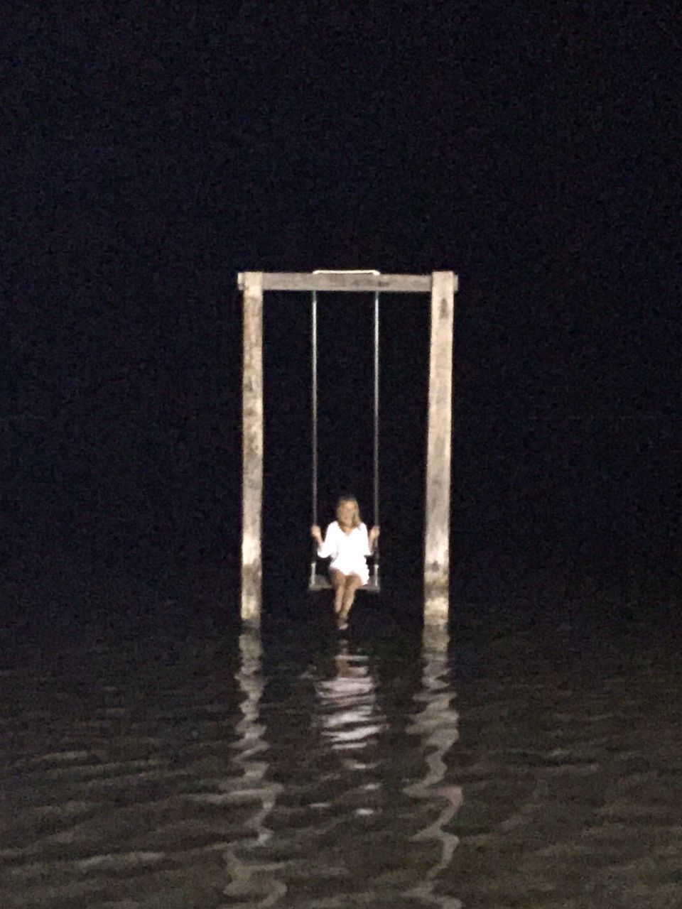 An idyllic spot to have a little swing at night in the Gili Islands