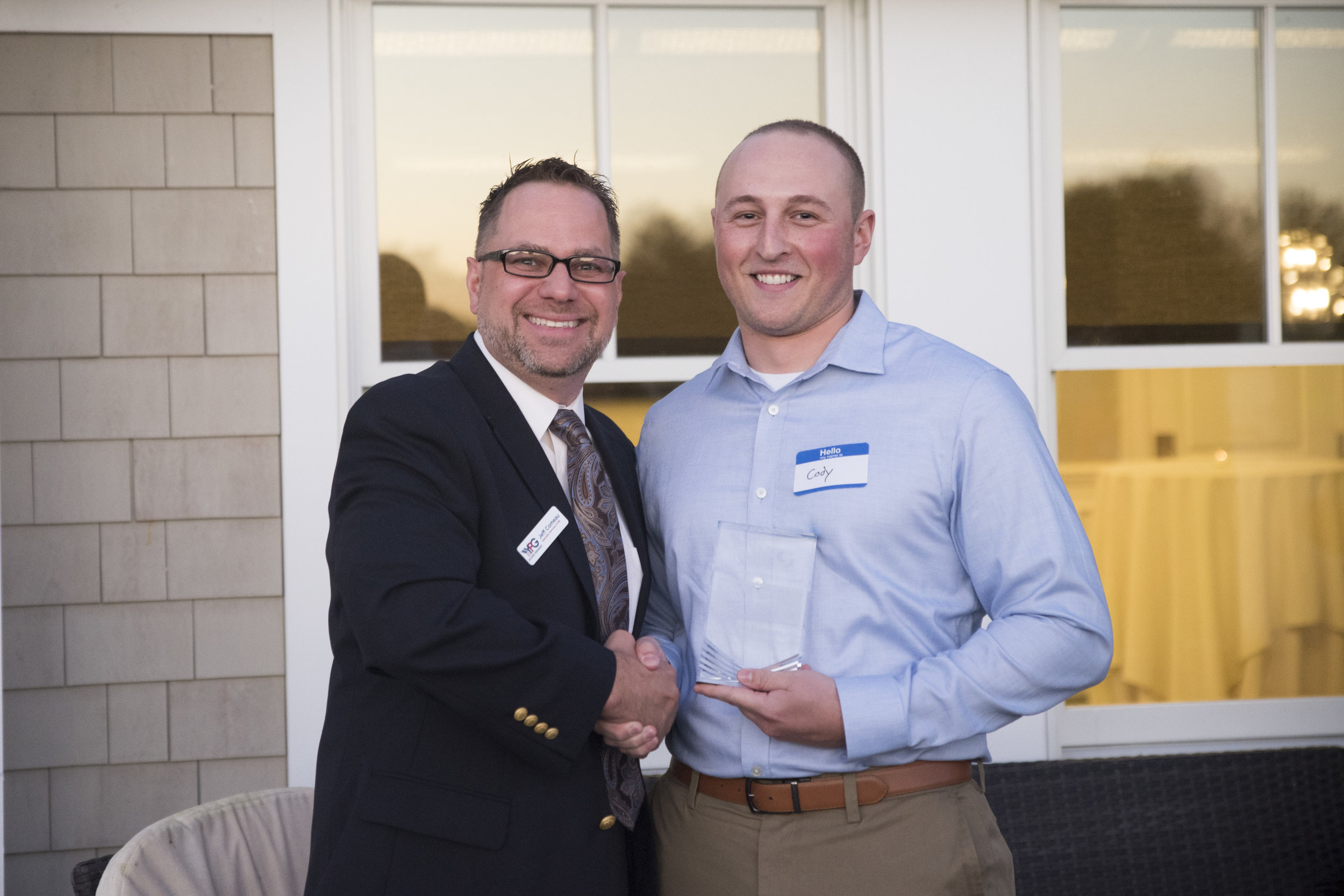 Methuen Construction's Cody Barnes accepts the 2018 YP of the Year Award from ABC YPG Board Chair Jeff Comeau