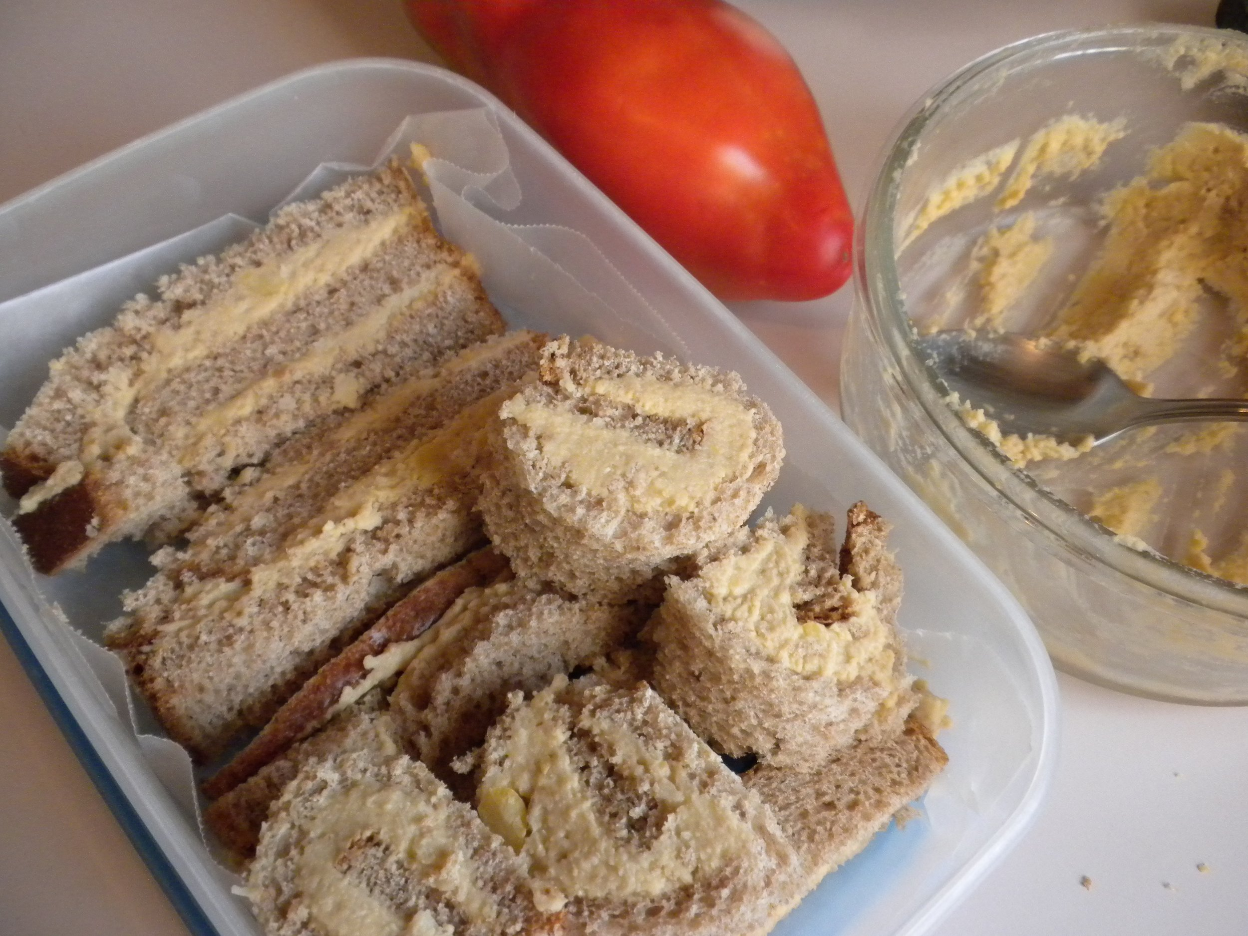 Hummus bars and pinwheel roll ups.   Snack Idea: For any time of the day! Try a Hummus or peanut butter sandwich!  Make a sandwich and cut into 4 - 1-inch wide bars or slice a piece of bread into 2 thin slices. Spread hummus or peanut butter on each half and roll each half and cut each into pinwheels like shape. Store covered in refrigerator.