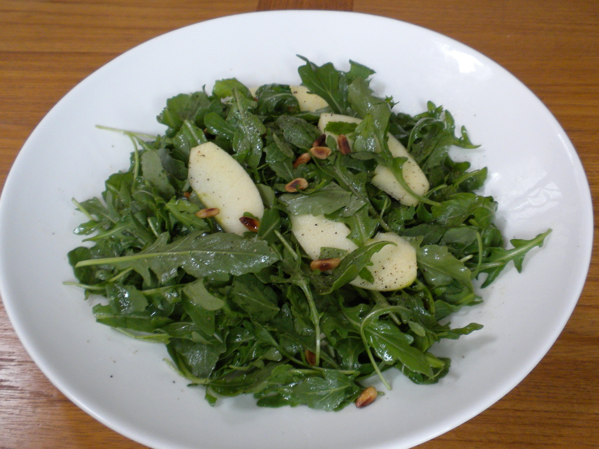 Arugula salad with pine nuts.  Rich in anti-inflammatory compounds and delicious!