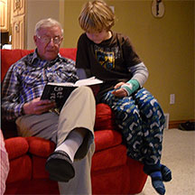 Grandpa Maguire reading the Christmas story December 25, 2011