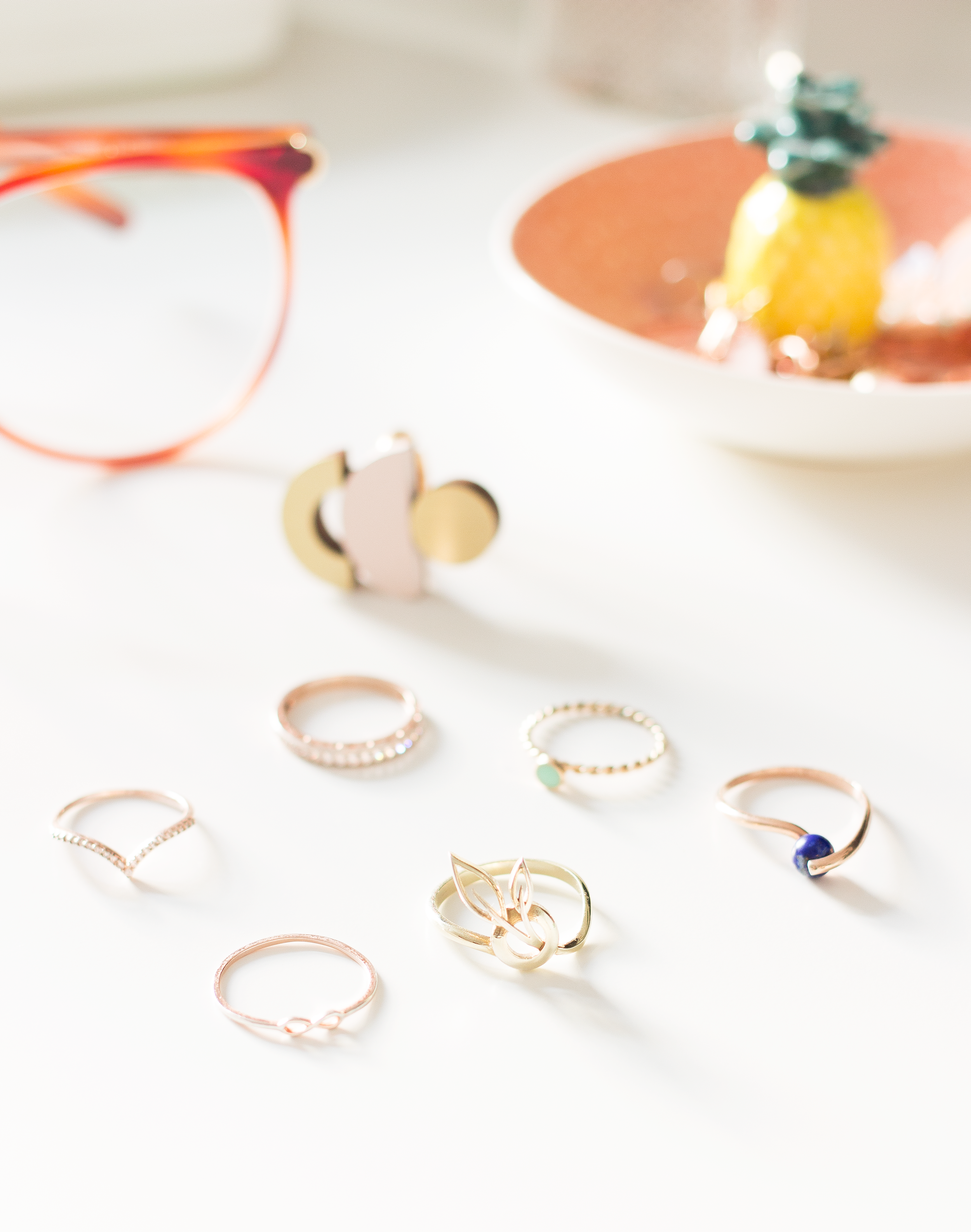 RINGS - Rings are always something that I've always had a soft spot for. From being a child and being totally obsessed with mood and birthstone rings to now where I'm in love with really dainty minimal pieces. I've been building up on my little ring collection for years and adding in pieces here and there and here are the details on all my pieces;The eternity and solid band with the jewels are from Jewellery Box, the wishbone band is from Debenhams. The gold band with the mint green disc is from Accessorizeand two of my latest pieces are from Maravilo*. And what sets those two pieces aside from the rest is that Maravilo is a site set up for small independent designers to showcase their work and for us the public to shop. And of course, the pieces are absolutely beautiful, in particular, the gold leaf ring it's such a unique item. I stack all these pieces together and love the mixture of the rose gold against the classic yellow and find they all work together in harmony.