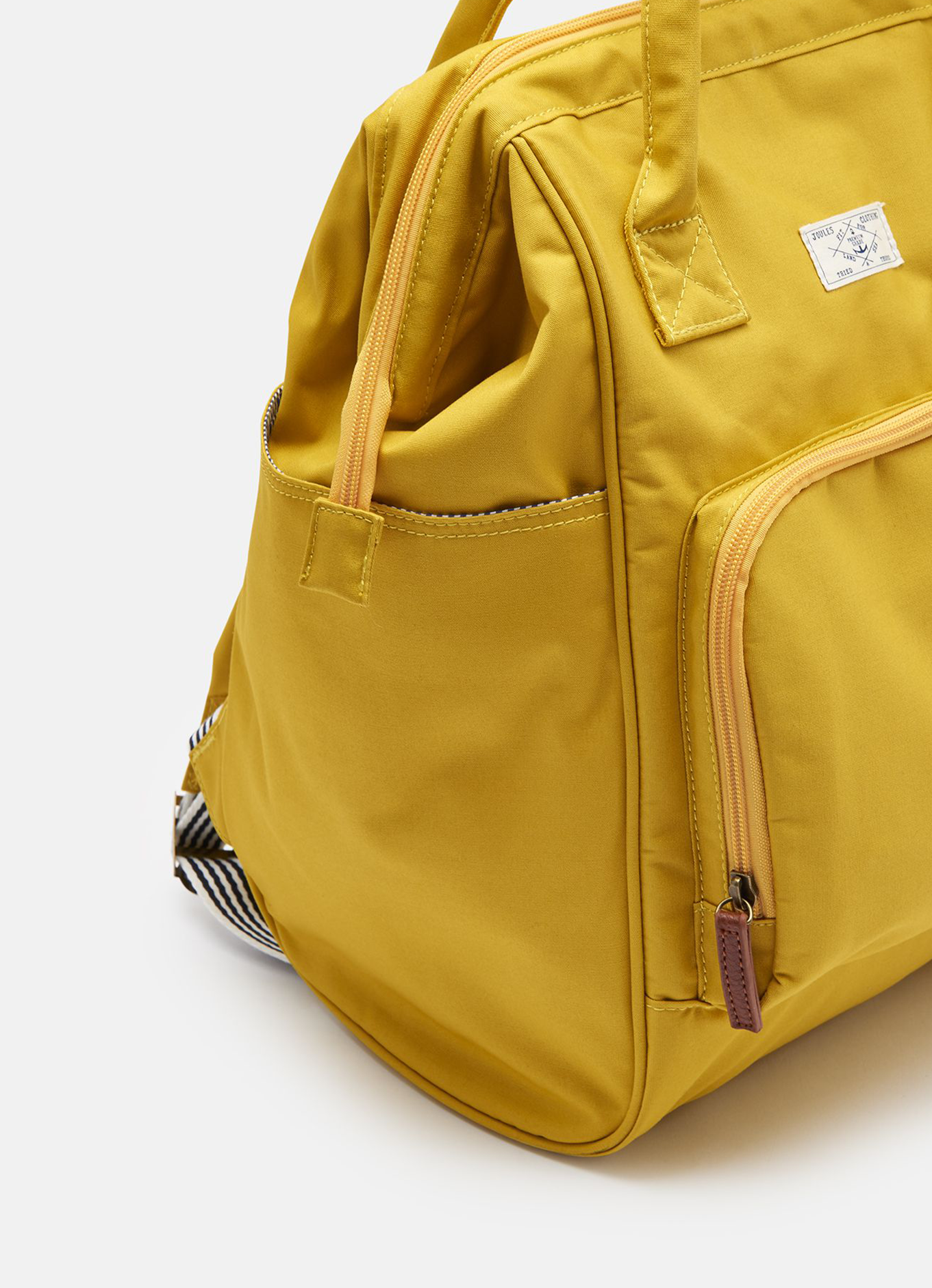 joules coast rucksack (gifted) - For practical reasons, if it's pouring with rain a backpack is probably the best thing to use. As much as I love pretty tote bags and rattan bags if there is one thing they're not cut out for it's the rain. Along side this beautiful bag I've also been using my beloved Kanken which is another great bag for the rain but I do find this one a little more comfortable if I have a lot of stuff with me. It looks nice and compact but it fits a huge amount in and it has a lot of compartments which is key for a large bag as it's all too easy for things to get lost. The yellow is a really lovely pop of colour in my otherwise pretty monochromatic wardrobe too.