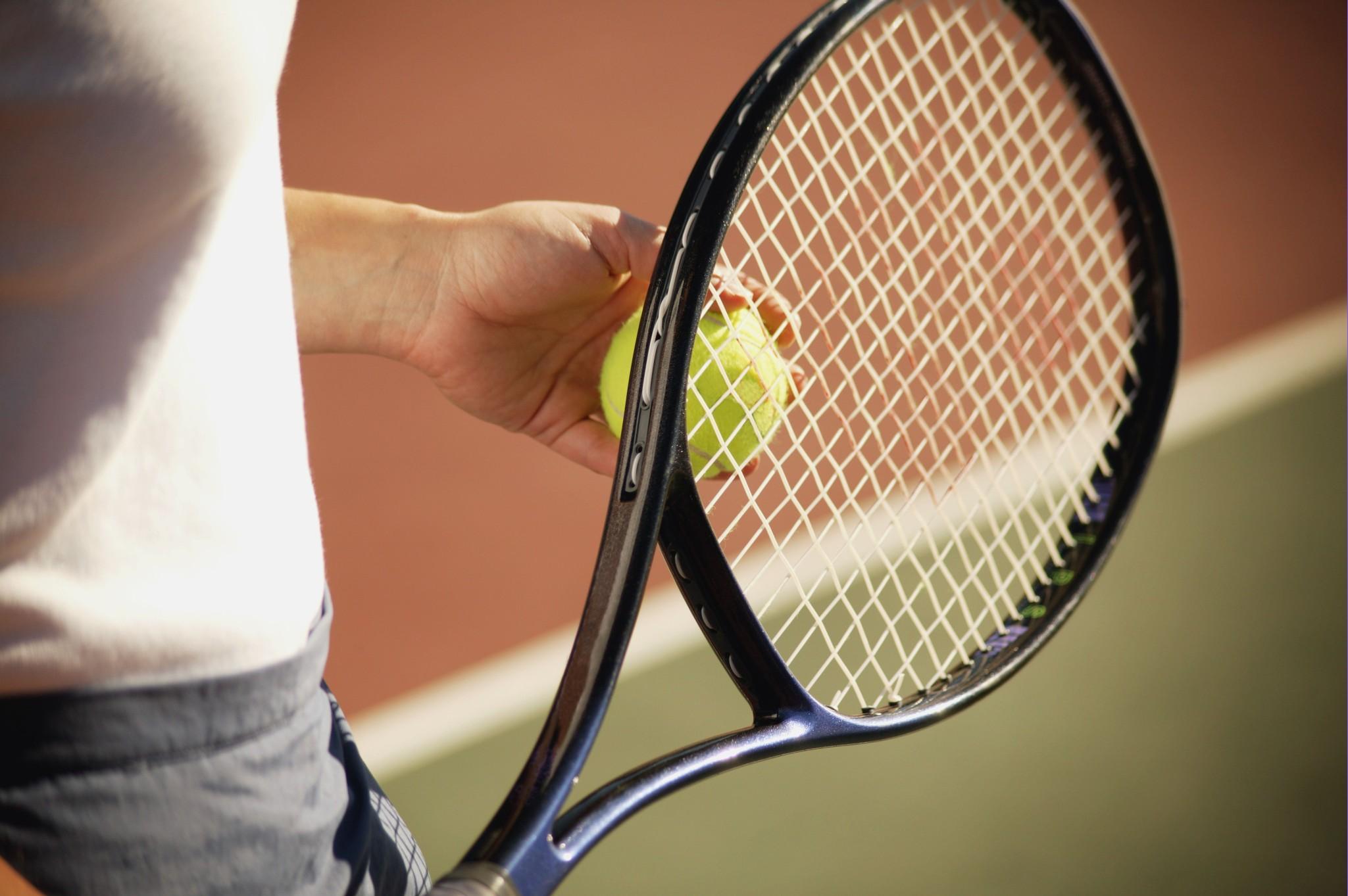 324562_med Woman holding racket (2).jpg