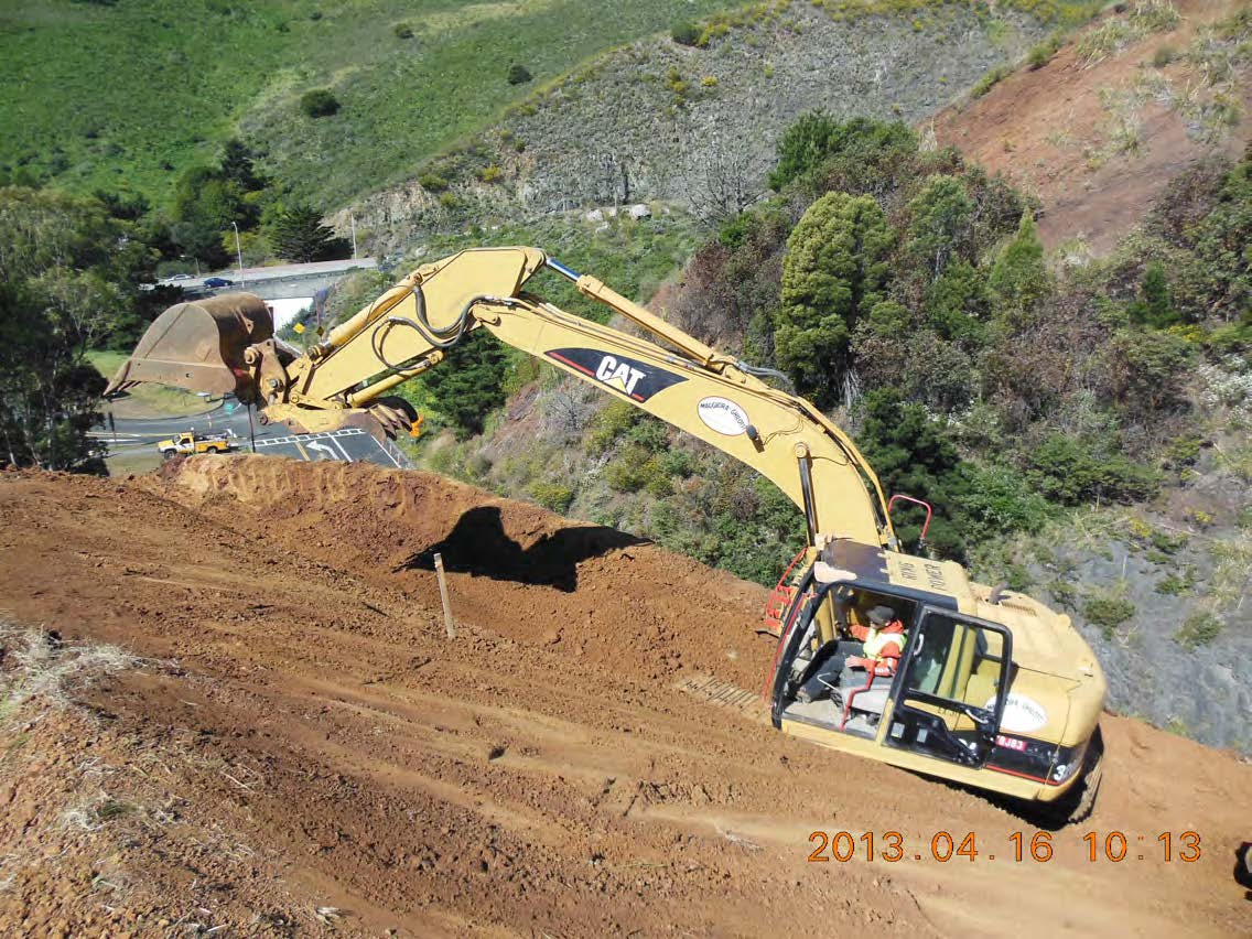 80' above Alexander Ave performing slope rounding and starting half to one cut slope