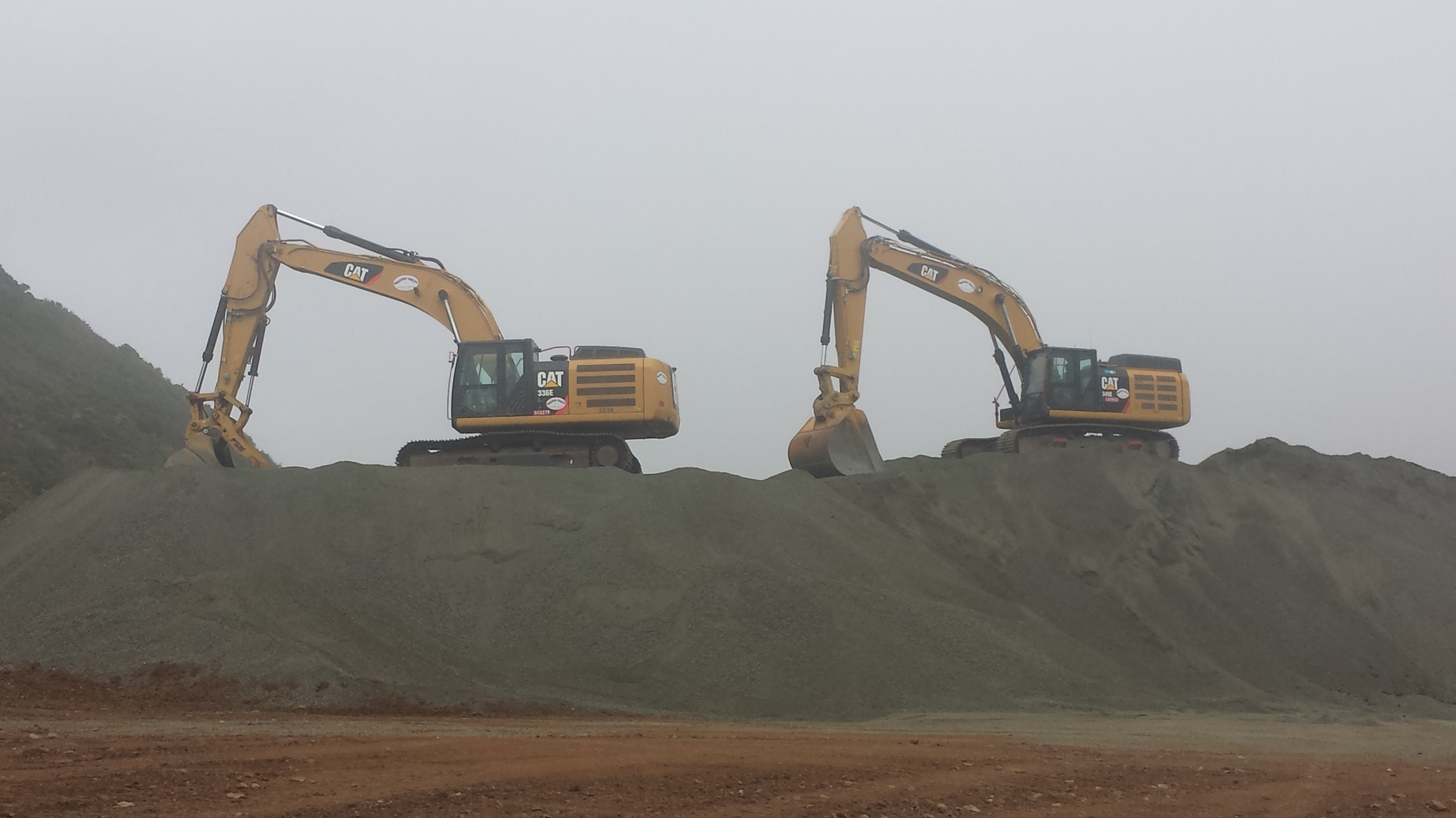 349 and 336 excavators on top of Blue Rock Base Rock stockpile from Alexander Avenue Cut