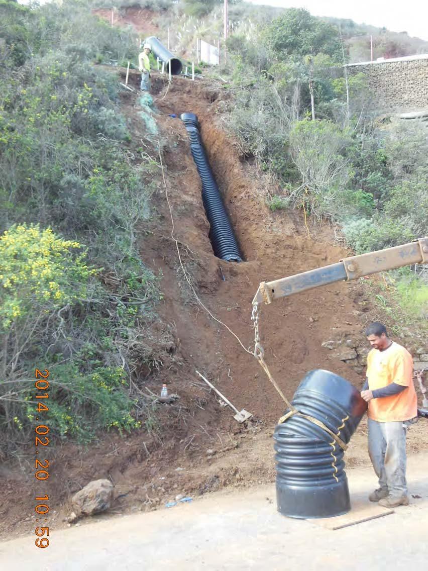 Installing new drain pipe below MSE wall below Alexander Avenue