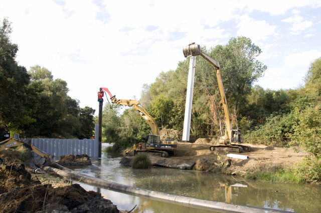 Swinging in additional vinyl sheets for upstream cofferdam