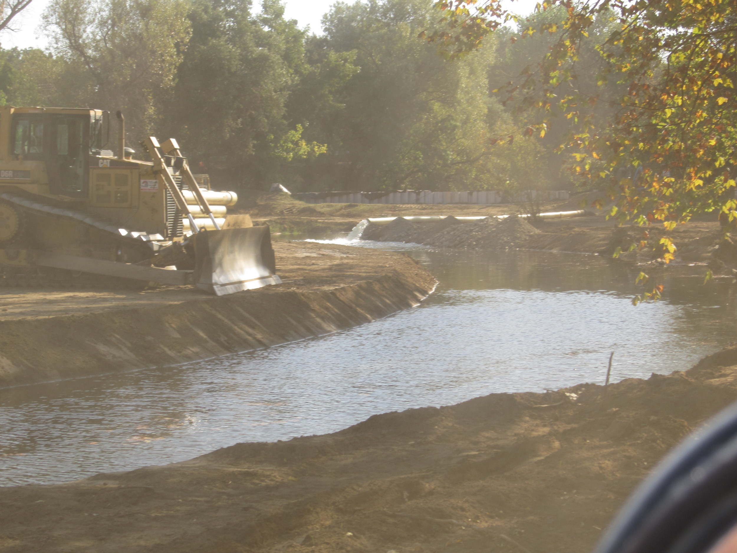 Preflooding of new channel before removal of cofferdams and restoration of flow