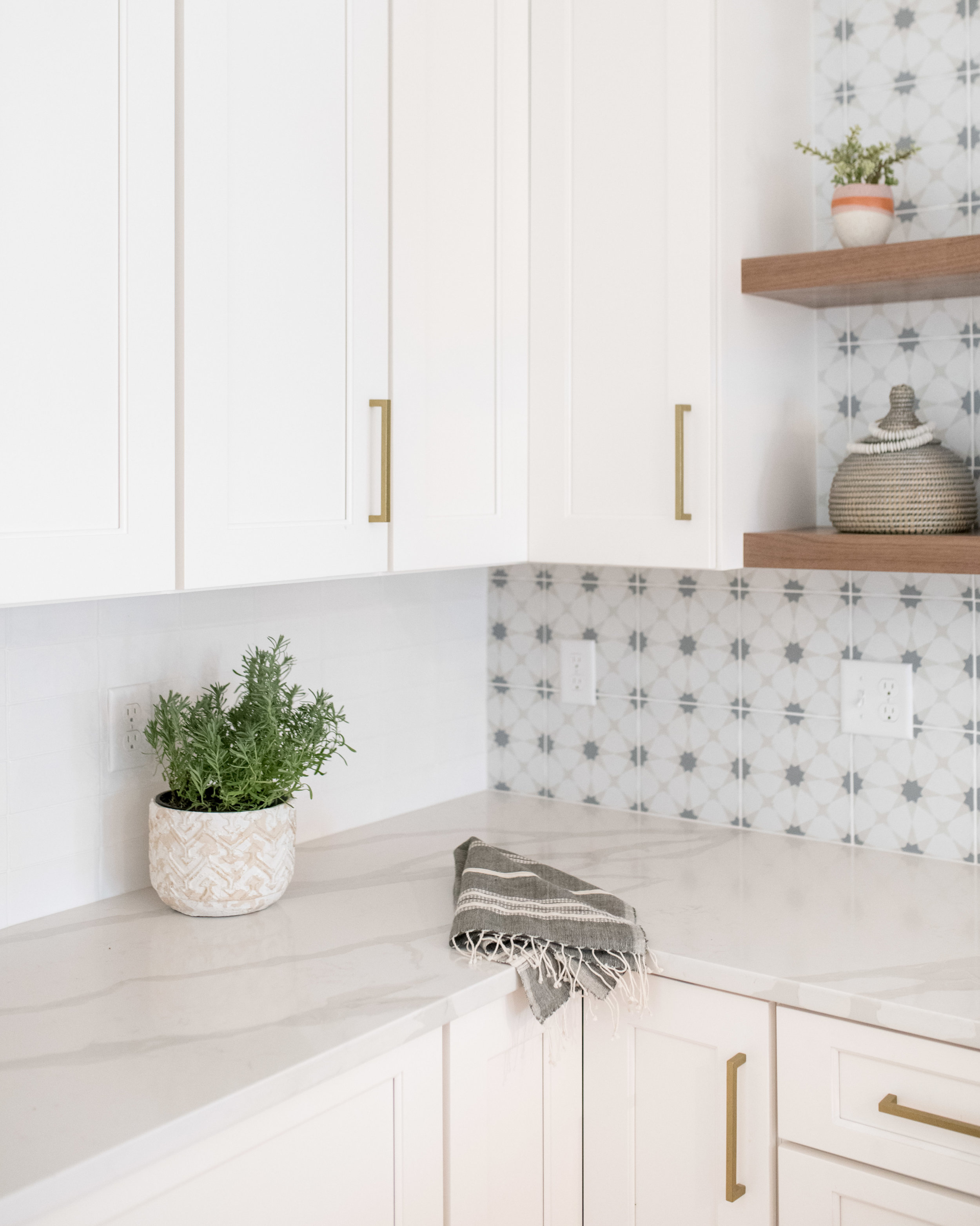 quartz countertops and graphic backsplash
