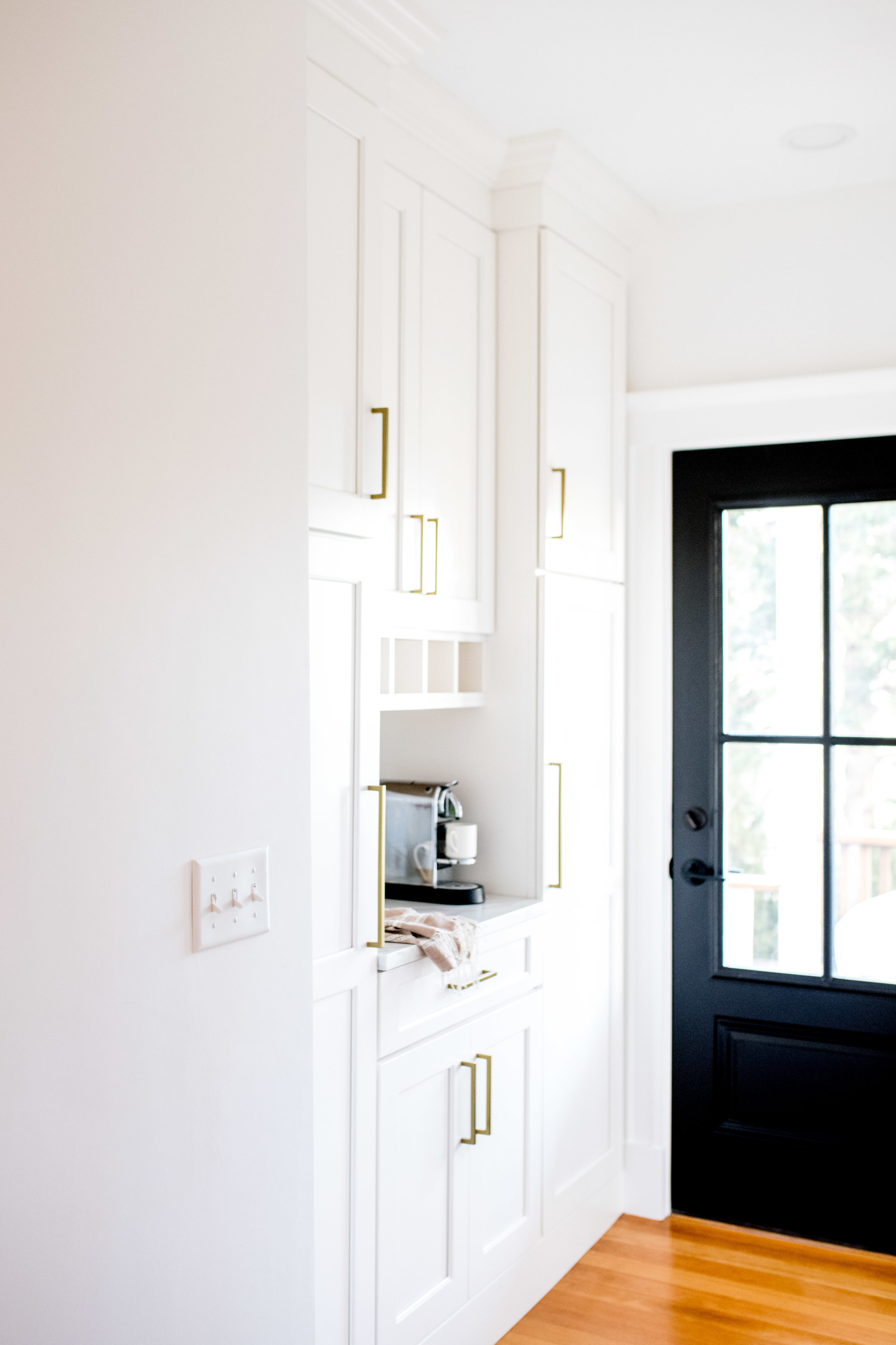 old hallway with window turned into pantry with door