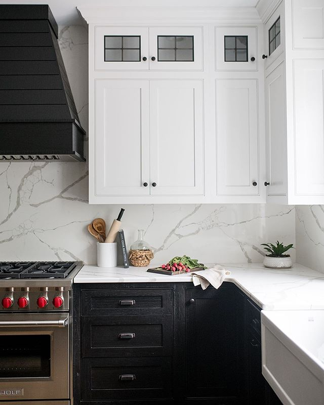 Leaded glass, custom hickory cabinets and stone booked matched from counters to backsplash.... yep, I'd say this is a kitchen would turn me into a wanna-be food blogger if it were mine. I make a mean taco people... interior @ginabaran | builder Dipietro Homes | pc @wearefreebird