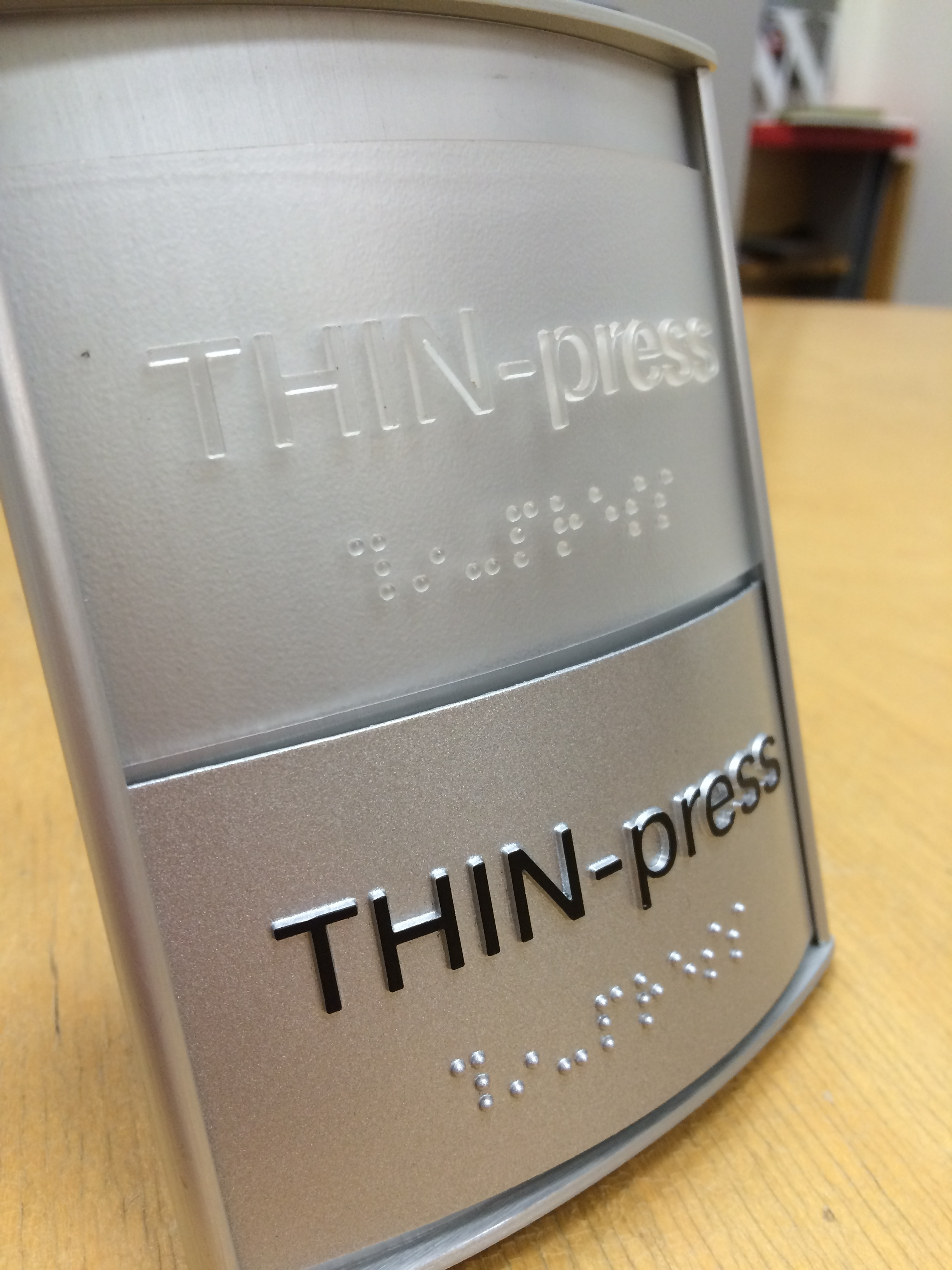 THIN-press Encompass Sign.JPG