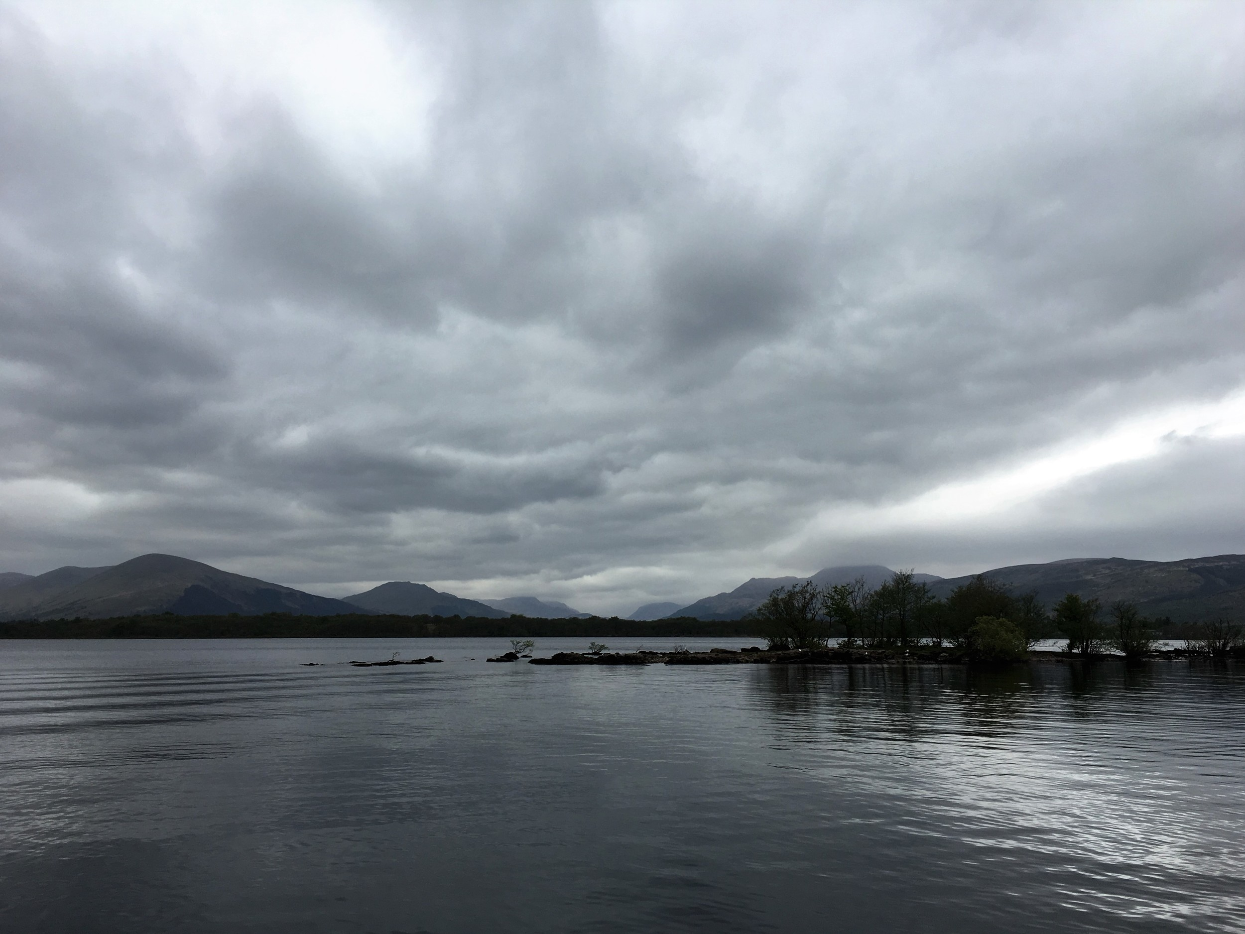 An atmospheric day with the spit of Inchcailloch and Ben Lomond in the background. Loch Lomond is one of those places where the weather doesn't really diminish the beauty of the view, it merely alters it.