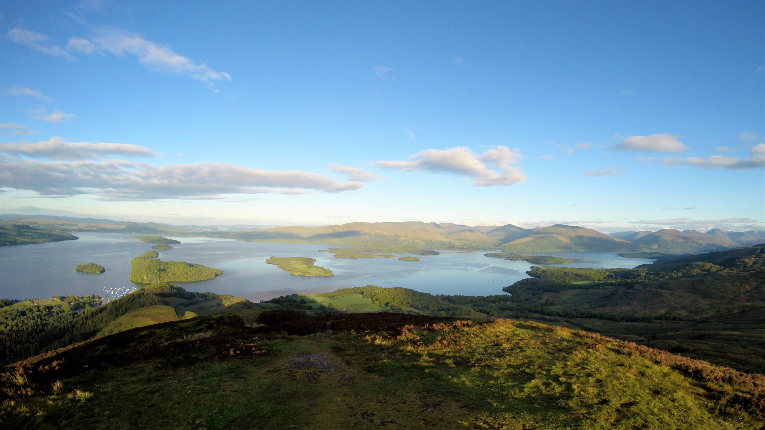 One of the most Iconic scenes from around Loch Lomond, the view from atop of Conic Hill,gazing out along the chain of Island's Inchcailloch, Torrinch, Creinch and Inchmurrin. They all help make up part of the Highland Boundary Fault line, which runs from Stonehaven in the East to the Isle of Arran in the West