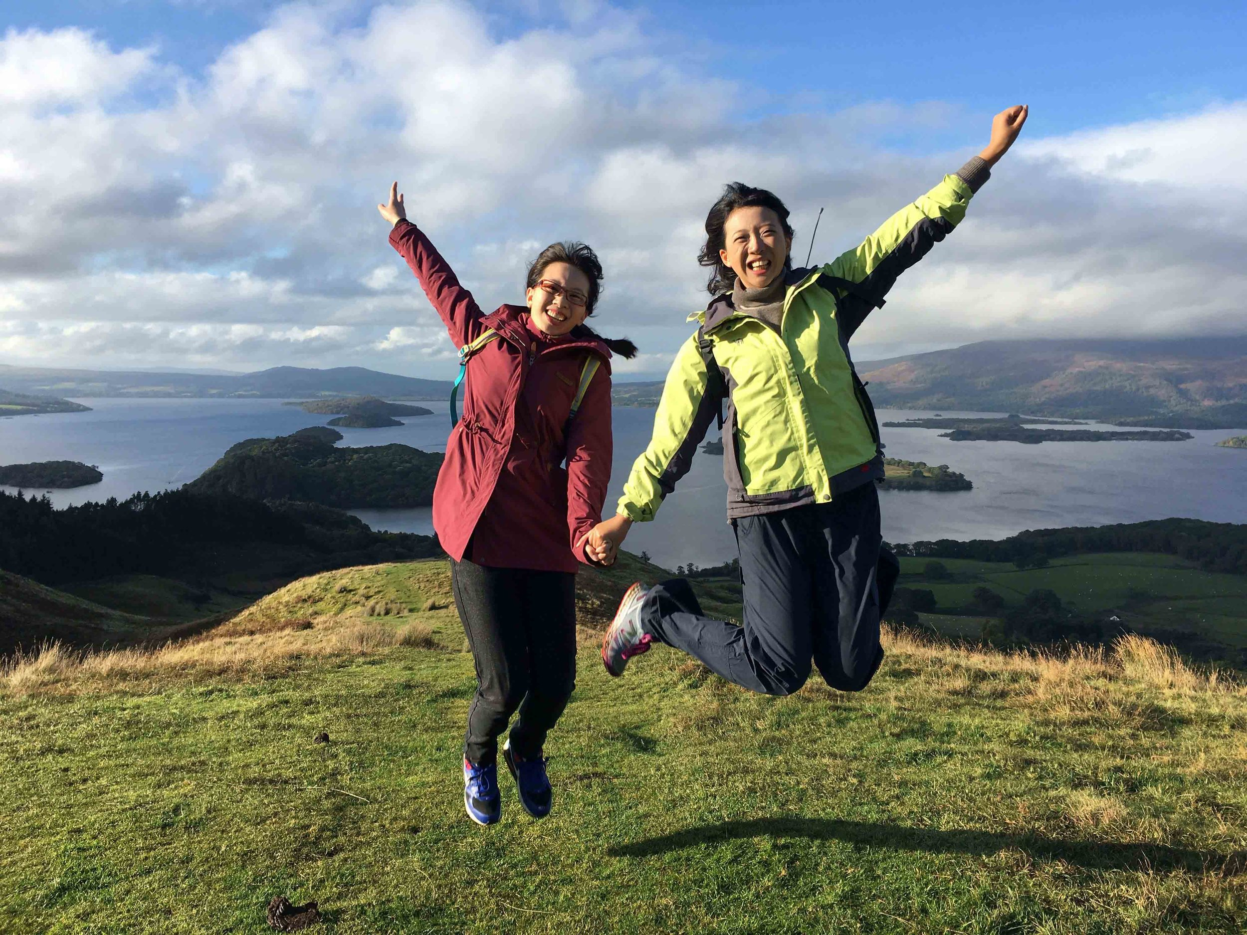 friends jumping for joy at loch lomond