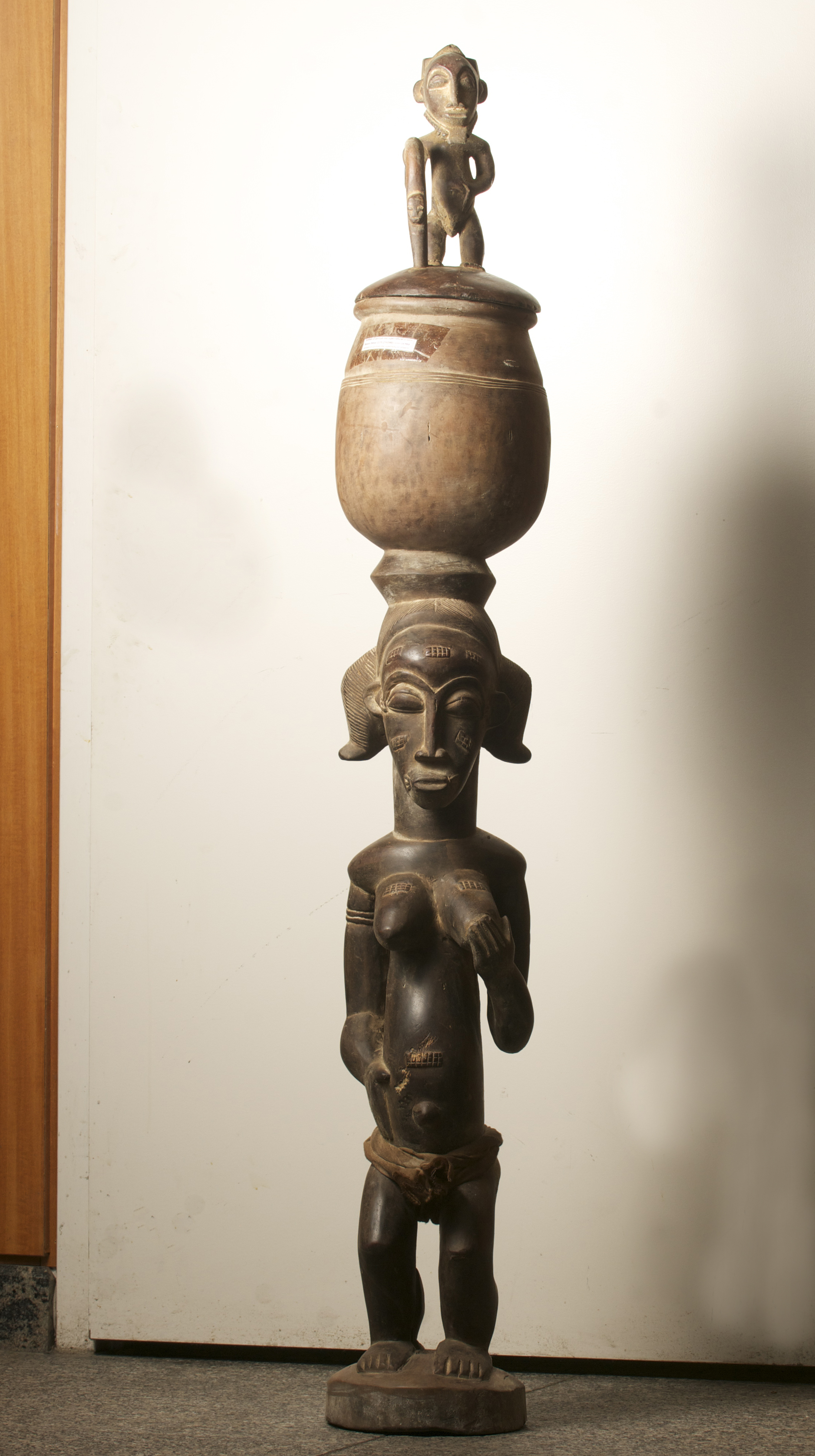 Baule figure with pot on head, Cote D'ivoire. height 59.7 inch. $2770.00.jpg