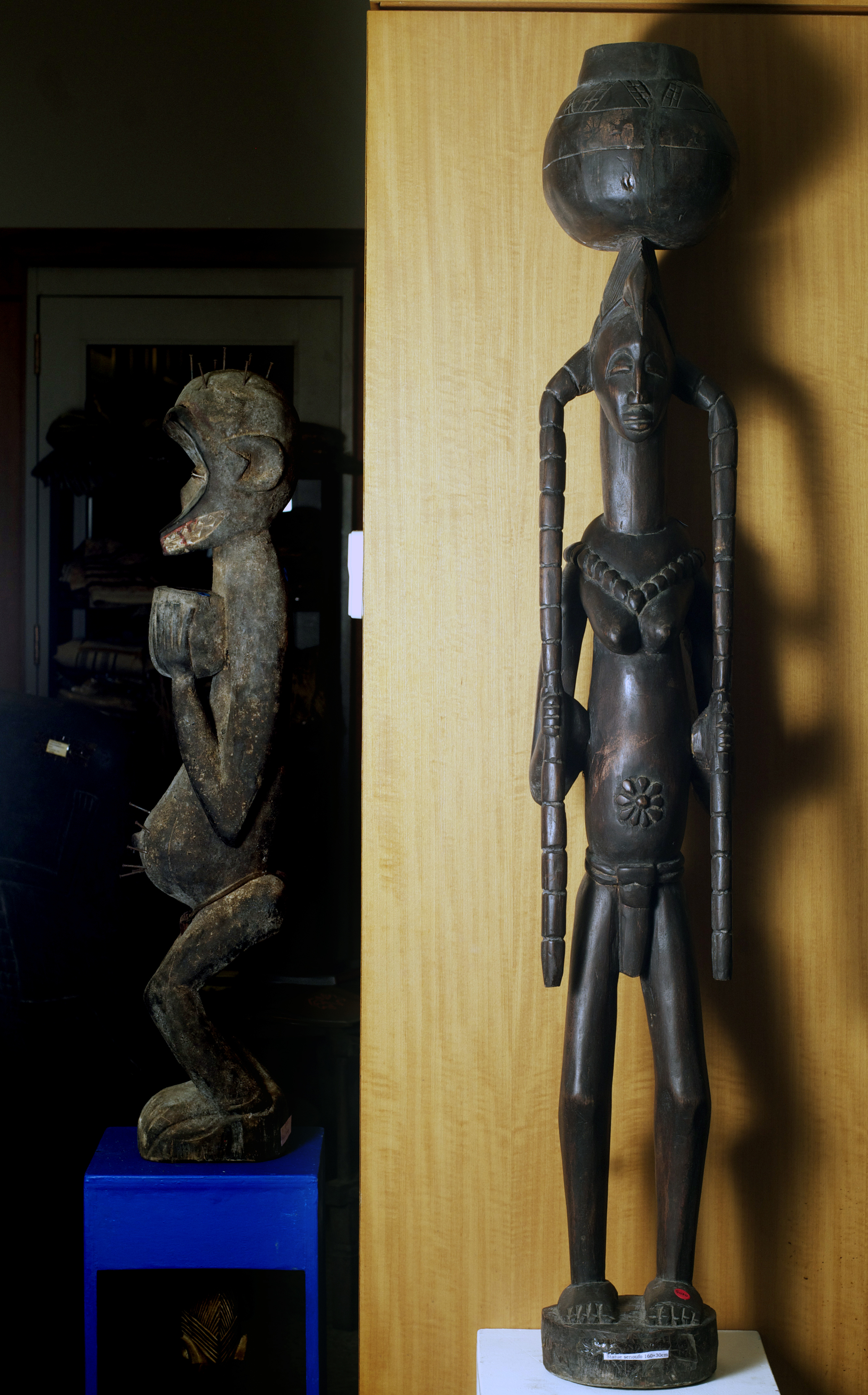 Senufo figure with pots, Cote D'Ivoire. Height 61.3 inch. Pp. $600.00.jpg