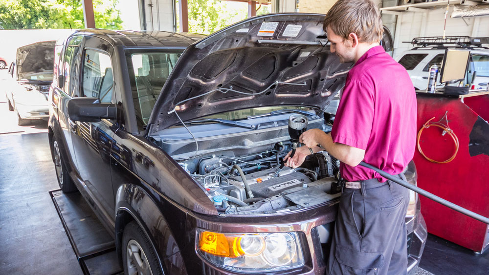 Fast Lane Oil Change Tigard mechanic working