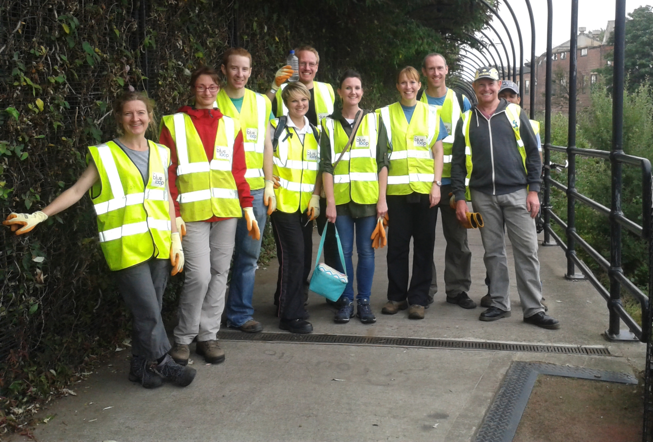Volunteers posing by the River Don on the Five Weirs Walk in Sheffield, after a hard day's graft as part of Sheffield City Council's Lower Don Valley Flood Defence Project.