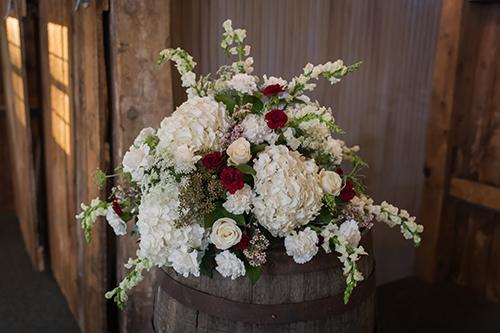 rustic wine barrels floral blooms wisconsin