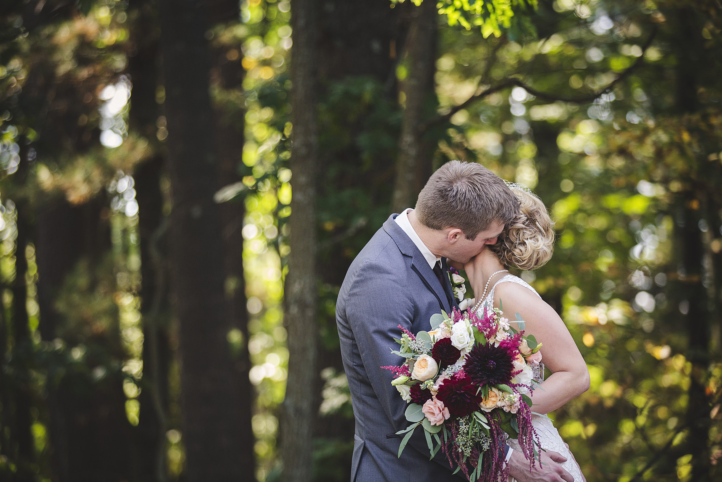 first look wedding kiss wedding planning day of coordinator event designer wisconsin dells wi