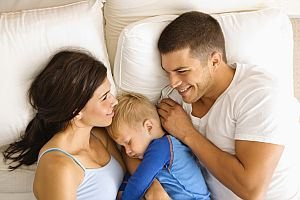 Family in bed.