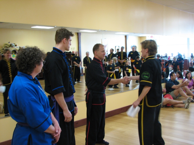 Holly receiving her first belt in Mantis Boxing. 2008
