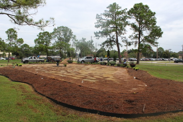 Stonework set, Fountain in place and mulch laid.