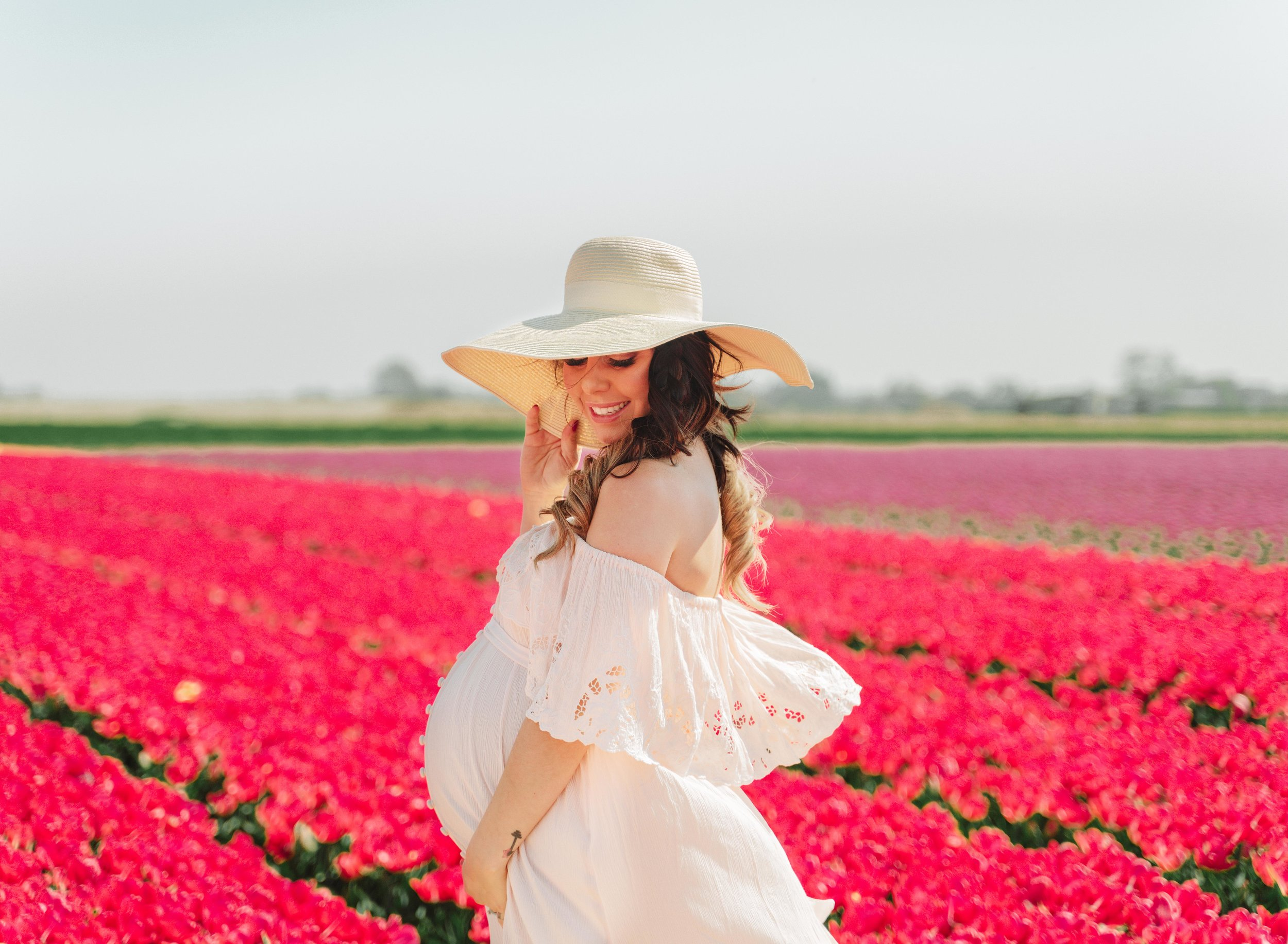 ramstein kmc maternity photography in tulip fields in Netherlands