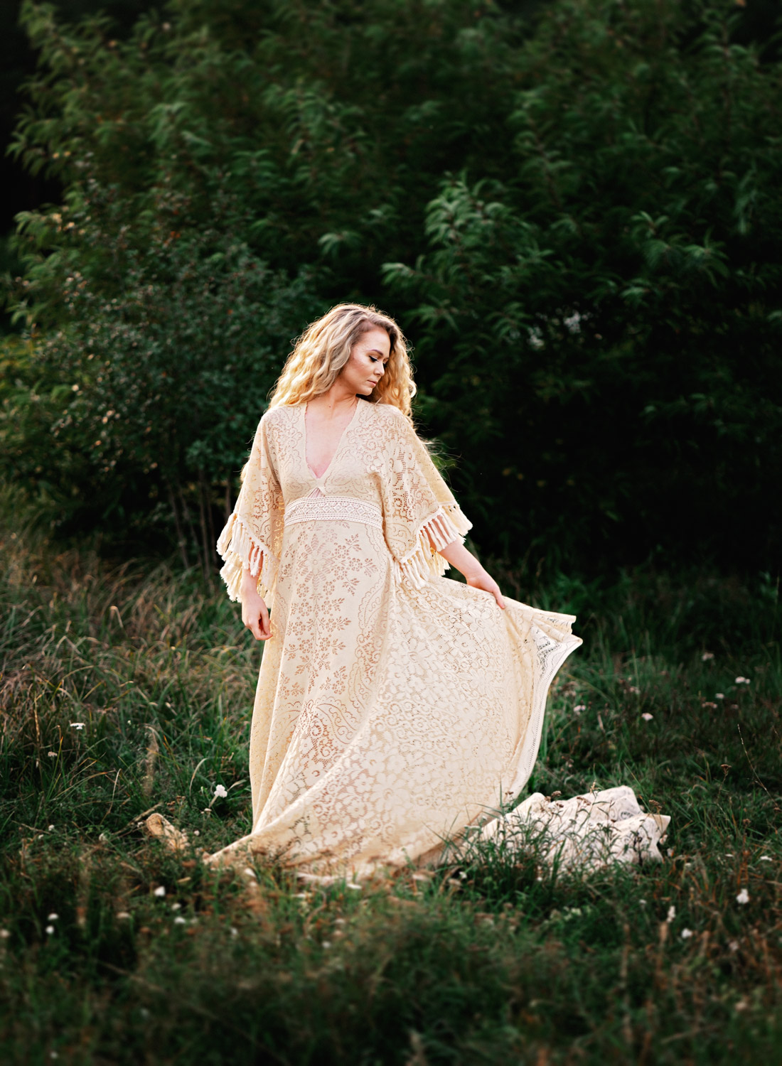boho portrait of young blonde woman in beautiful boho chique dress in greenery by German fashion photographer sarah havens