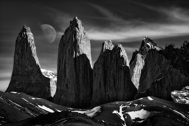 """Patagonia Rising"" was taken during a visit to Torres Del Paine National Park, in the Patagonia region of South America.  This is not a composite, but one image shot at 420mm to compress the moon in the scene. While composing this image, I wanted to showcase the impressive size of the setting moon against the extraordinary peaks of Las Torres.  #NikonD850 #Tamron #reallyrightstuff #Patagonia #ig_landscape  #dream_spots #visual_heaven #landscapephoto #landscape_lover #natgeoadventure #earthexperience #mthrworld #majestic_earth  #igworldglobal #ilovenature #ig_divineshots #EarthOfficial  #earth_shotz #marvelshots #theworldshotz #discoverglobe #landscapelover #landscapehunter  #igbest_shotz #natgeoyourshot  #natgeotravelpic #epic_captures"