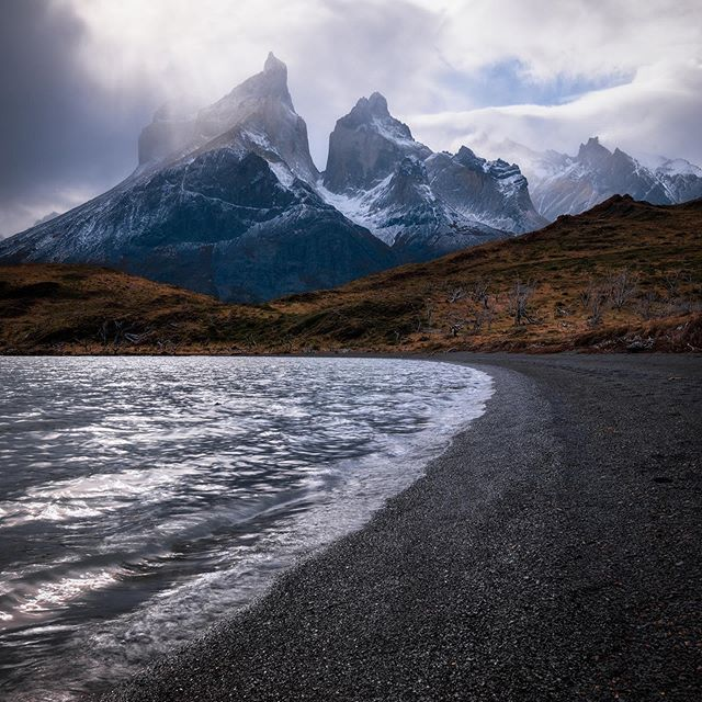 During a hike in Torres Del Paine we spent a little time wandering on this beach, mesmerized by the swirling clouds and changing light.  #torresdelpainenationalpark #patagoniachile #patagonia #torresdelpaine #chile  #pocket_world #ig_landscape  #dream_spots #visual_heaven #landscapephoto #landscape_lover #natgeoadventure #earthexperience #mthrworld #majestic_earth  View the hi-res version and more images from Patagonia via link in bio.  #igworldglobal #ilovenature #ig_divineshots #EarthOfficial  #earth_shotz #marvelshots #theworldshotz #discoverglobe #landscapelover #landscapehunter
