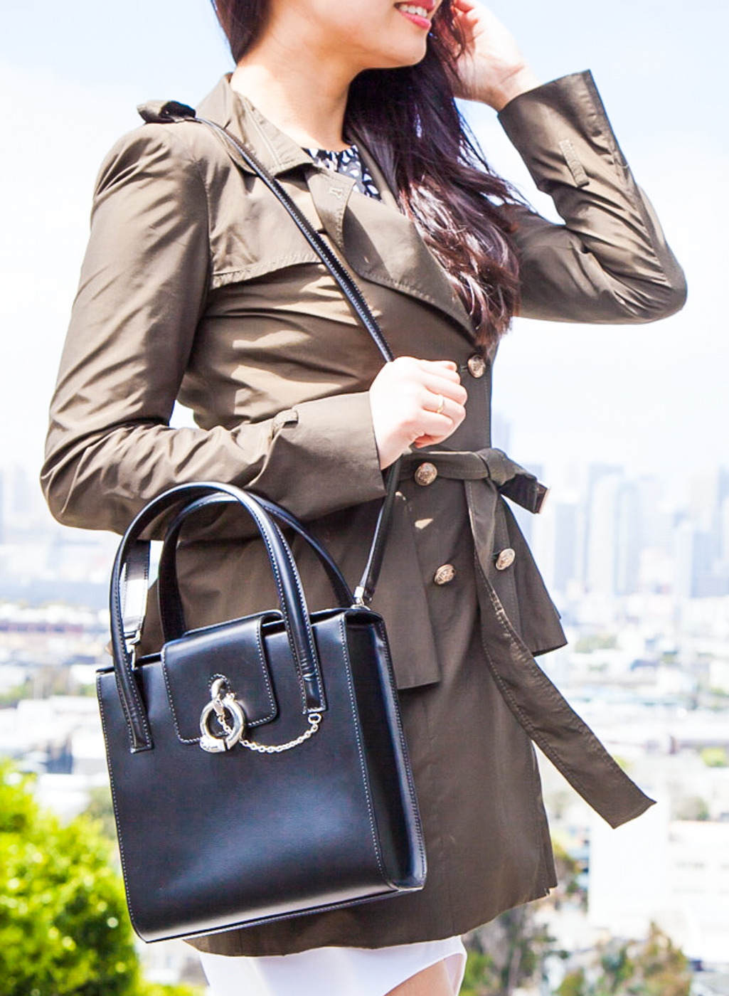 Olive trench coat and structured Cartier bag