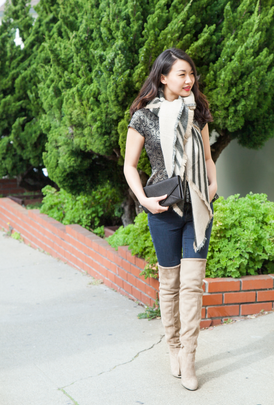 Oversized blanket scarf and soft knee-high boots | via The Chic Diary