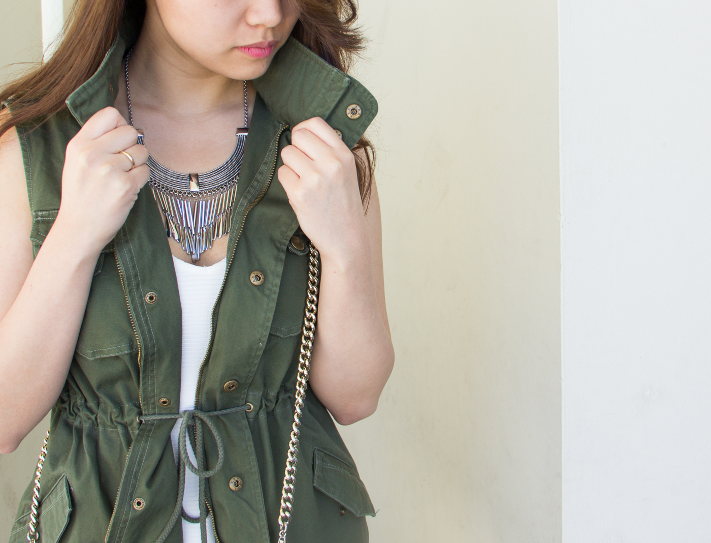 Military vest & statement necklace   via The Chic Diary